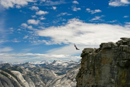 mountains-cliff-clouds-jump-nature