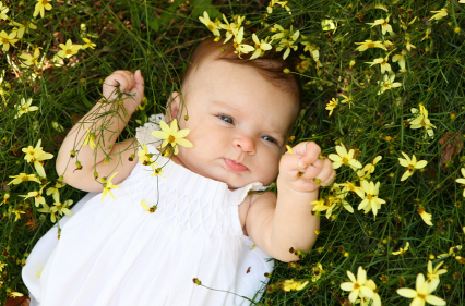 baby in flowers