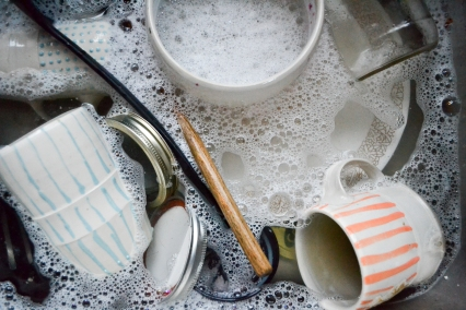 cups in suds in sink