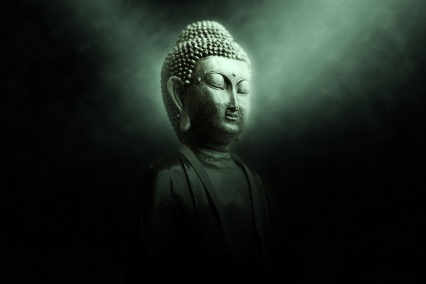 green meditating buddha