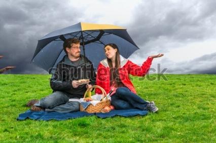 picnic couple rain